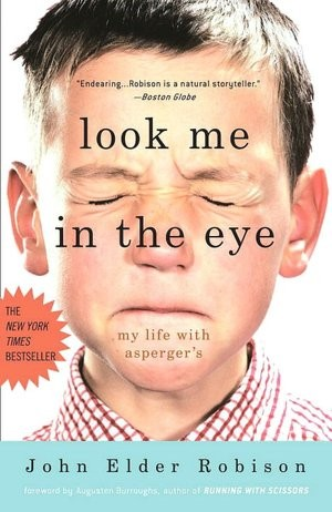 The book cover for Look Me In The Eye by John Elder Robinson that has a boy's face on a white background.