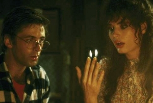 A picture of the characters Adam and Barbara Maitland in the movie Beetlejuice with Barbara's fingers on fire.