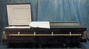 A picture of a casket or coffin with the top half open.