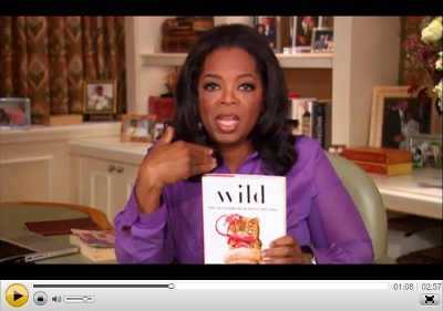 A picture from a video of Oprah Winfrey talking about the book Wild by Cheryl Strayed as the inspiration for making Oprah's Book Club 2.0