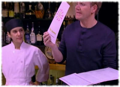 Gordon Ramsay holding up the new menu for Fiesta Sunrise on Kitchen Nightmares episode.