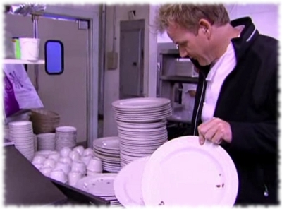 Chef Gordon Ramsay looking at plates of roaches in Fiesta Sunrise's kitchen on Kitchen Nightmares.