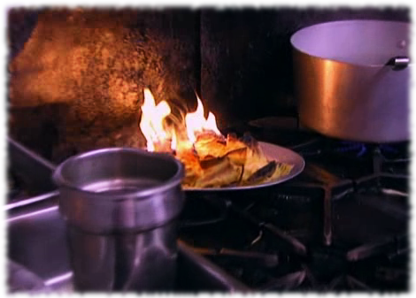 Picture of a plate of nachos that are on fire at the Fiesta Sunrise restaurant on Gordon Ramsay's Kitchen Nightmares show.