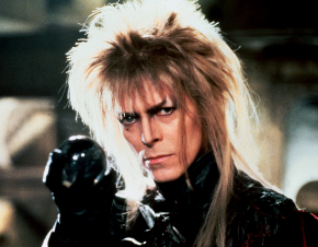 A picture of David Bowie playing the Goblin King in Labyrinth, holding a crystal ball.